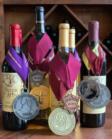 5 bottles of wine with medals and awards